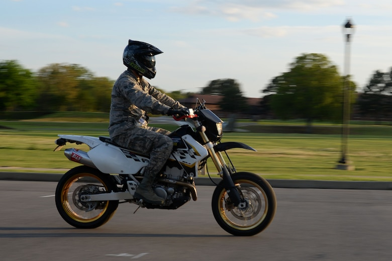 U.S. Air Force Airman 1st Class Omar Campos, 19th Maintenance Squadron crew chief, rides his bike April 5, 2017, at Little Rock Air Force Base, Arkansas. Active duty military members who operate a motorcycle both on and off Little Rock Air Force Base and anyone operating a motorcycle on the base, including passengers, must comply with personal protective equipment requirements as prescribed in Air Force Instruction 91-207, USAF Traffic Safety Program. (U.S. Air Force photo by Airman 1st Class Codie Collins)