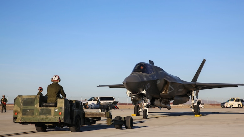 Marines with Marine Fighter Attack Squadron (VMFA) 211 prepare to conduct a hot load on an F-35B Lightning II at Marine Corps Air Station Yuma, Ariz., April 4.  Marines with VMFA-211 along with Marine Aviation Weapons and Tactics Squadron (MAWTS) 1, conducted hot loads during the semiannual Weapons and Tactics Instructor Course (WTI) 2-17. Lasting seven weeks, WTI is a training event hosted by MAWTS-1 that provides standardized advanced and tactical training and certification of unit instructor qualifications to support Marine aviation training and readiness.