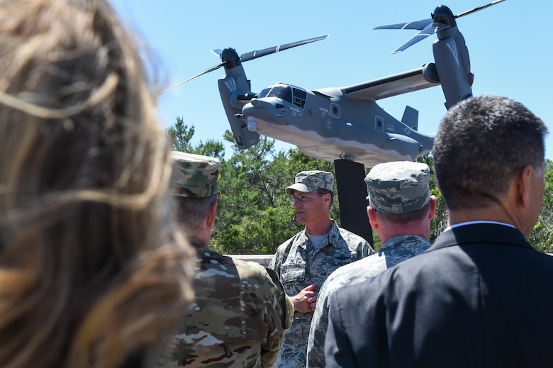 Col. Thomas Palenske, the commander of the 1st Special Operations Wing, speaks during the CV-22 Osprey model dedication ceremony at Hurlburt Field, Fla., April 6, 2017. The CV-22 model, with tail number 0031, was created and installed to memorialize the CV-22 that crashed near Qalat, Afghanistan, April 9, 2010, where two of the crew members lost their lives. (U.S. Air Force photo by Senior Airman Jeff Parkinson)