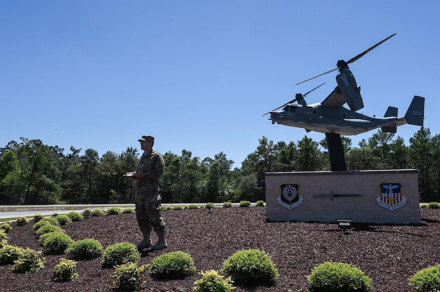 Staff Sgt. Bryan Sibley, a crew chief with the 801st Special Operations Aircraft Maintenance Squadron, welcomes attendees to the CV-22 Osprey model dedication ceremony at Hurlburt Field, Fla., April 6, 2017. The CV-22 model, with tail number 0031, was created and installed to memorialize the CV-22 that crashed near Qalat, Afghanistan, April 9, 2010, where two of the crew members lost their lives. (U.S. Air Force photo by Senior Airman Jeff Parkinson)