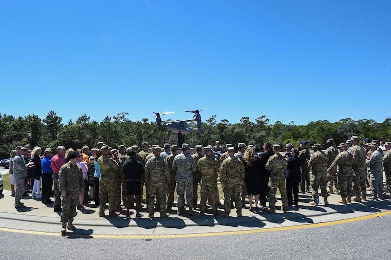 Members of team Hurlburt gather to dedicate the new CV-22 Osprey model at Hurlburt Field, Fla., April 6, 2017. The CV-22 model was donated by the Boeing Company to showcase the capabilities of the CV-22 and to show their appreciation of their partnership with the Air Force. (U.S. Air Force photo by Senior Airman Jeff Parkinson)