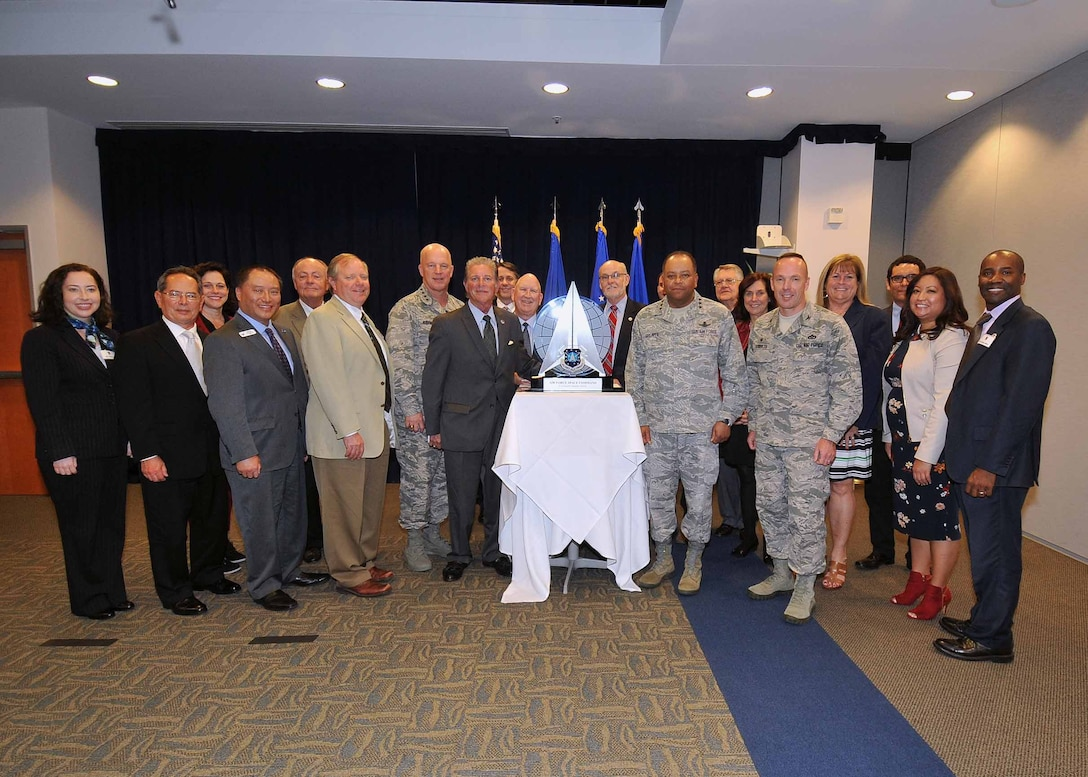 U.S. Air Force Gen. Jay Raymond, Commander, Air Force Space Command, and Lt. Gen. Samuel Greaves, commander of the Space and Missile Systems Center and Program Executive Officer for Space, and Col. Charles Roberts, commander of the 61st Air Base Group, stand with members of the South Bay Association of Chambers of Commerce during a ceremony at Los Angeles Air Force Base, El Segundo, Calif., Feb. 15, 2017. The SBACC was named the recipient of the 2016 Air Force Space Command Community Support Award for their outstanding support to the mission and personnel of SMC and Los Angeles Air Force Base. (U.S. Air Force photo by Sarah Corrice)