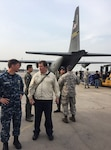 Navy Capt. H. Scott Johnson, left, and Tim Callaghan, Latin America regional chief, U.S. Agency for International Development, discuss flood relief plans on arrival at Grupo Ocho Peruvian Air Force Base, Peru, April 6, 2017. The U.S. military is assisting with relief efforts following torrential rains that flooded cities in northern Peru. DoD photo