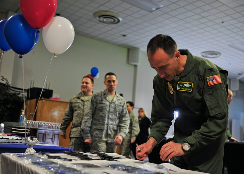 Col. Leonard Kosinski, 62nd Airlift Wing commander, fills out an Air Force Assistance Fund donation form at the AFAF kick-off event, April 6, 2017 at the McChord Field Chapel Support Center. Team McChord hopes to raise $51,576 in donations throughout the campaign, which lasts from April 10 through May 19. (U.S. Air Force photo/Staff Sgt. Whitney Amstutz)