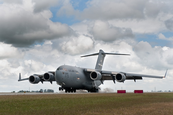 A C-17 Globemaster III from the 21st Airlift Squadron lands at Travis Air Force Base, Calif., May 8, 2014. In 2016, the 21st AS flew the most hours of any C-17 squadron in the Air Force, accumulating nearly 8,600 flying hours supporting missions on six continents. (U.S. Air Force photo/Ken Wright)