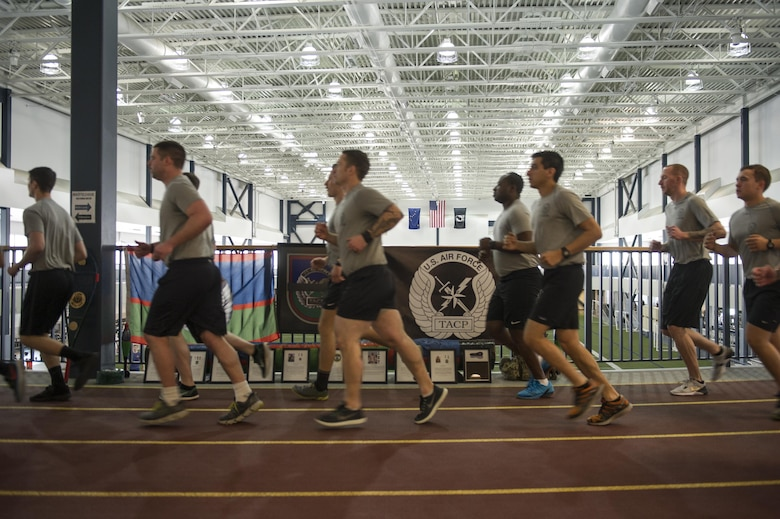 U.S. Air Force Tactical Air Control Party (TACP) Airmen assigned to Detachment 1, 3rd Air Support Operations Squadron, run in formation March 30, 2017, at the Baker Field House on Eielson Air Force Base, Alaska. At the beginning and end of the 24-hour run, all of the TACP Airmen ran together in formation, but during the rest of the run, the Airmen encouraged and received base participation. (U.S. Air Force photo by Airman 1st Class Isaac Johnson)