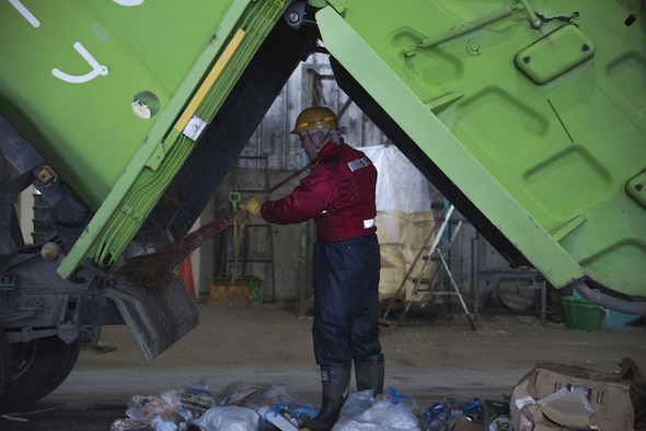 A Japanese national recycling center trash sorter clears out a dump truck at Misawa City, Japan, Mar. 20, 2017. Misawa Air Base, disposes of approximately 6,300 tons of trash a year with 31 percent of the trashrecycled. Currently the base is at a 31 percent recycling rate, with a goal to achieve a 65 percent recycling rate by 2020 (U.S. Air Force photo by Airman 1st Class Sadie Colbert)