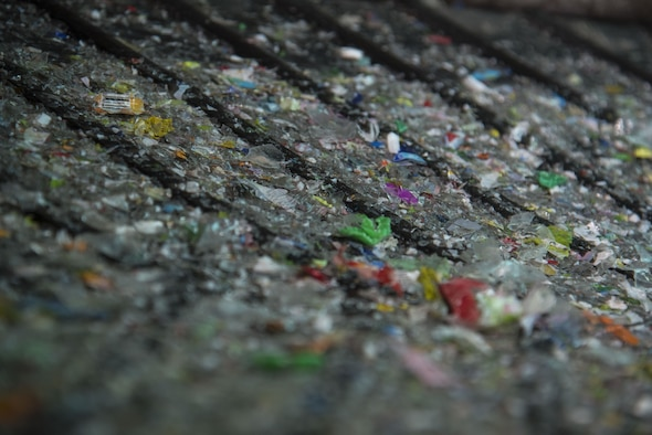 Remnants of shredded plastic sit on a conveyor belt at Misawa City, Japan, Mar. 20, 2017. Items like plastic bottles, glass and cardboard are recycled to be used for different purposes throughout Japan. (U.S. Air Force photo by Airman 1st Class Sadie Colbert)