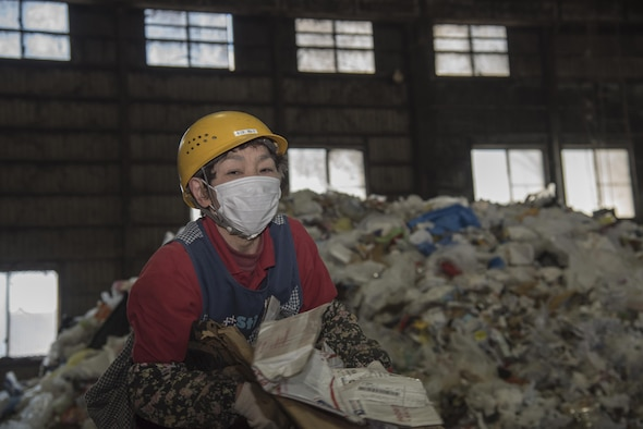 Chizu Yoko, a recycling center employee, begins separating trash received from military housing at Misawa, Japan, March 20, 2017. Currently Misawa recycles 31 percent of their trash with the plan to increase to 65 percent by year 2018. (U.S. Air Force photo by Airman 1st Class Sadie Colbert)