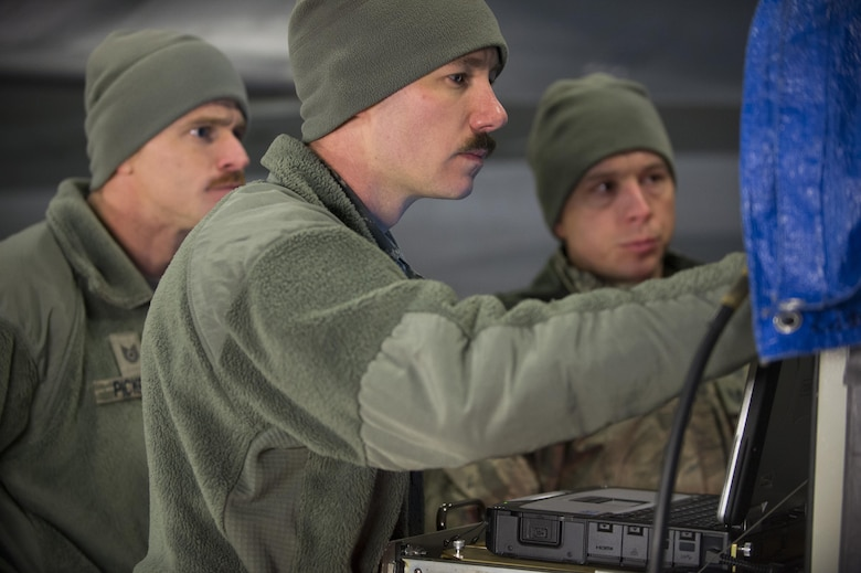 Staff Sgt. John Holm, center, Tech. Sgt. Jesse Pickrell, left, and Tech. Sgt. Matthew Hoover, Combat Shield team