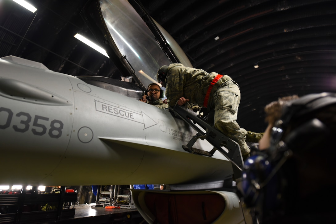 Airmen assigned to the 52nd Maintenance Group prepare an F-16 Fighting Falcon for the annual Combat Shield inspection at Spangdahlem Air Base, Germany, March 23, 2017. A Combat Shield team visited Spangdahlem March 20-24 to evaluate the reliability of several F-16s' radar threat warning systems and countermeasures. (U.S. Air Force photo by Senior Airman Dawn M. Weber)