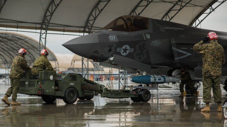 Marines with Marine Fighter Attack Squadron (VMFA) 121 load ordnance on an F-35B Lightning II aircraft during hot-reload training at Marine Corps Air Station Iwakuni, Japan, April 6, 2017. This signified the first time the squadron loaded ordnance onto a running F-35B Lightning II aircraft at the air station in order to prepare for real-world scenarios.