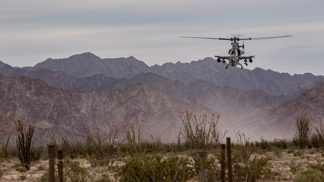 A Marine AH-1Z Venom attached to Marine Aviation Weapons and Tactics Squadron One (MAWTS-1) maneuvers during an urban close air support (UCAS) exercise in support of Weapons and Tactics Instructor Course (WTI) 2-17 at Yodaville, Ariz., April 6, 2017. The UCAS exercise was designed to focus on specific employment of tactical air and rotary wing offensive air support aviation assets in order to support the ground combat element scheme of maneuver. WTI is a seven-week training event hosted by MAWTS-1 cadre, which emphasizes operational integration of the six functions of Marine Corps aviation in support of a Marine Air Ground Task Force and provides standardized advanced tactical training and certification of unit instructor qualifications to support Marine Aviation Training and Readiness and assists in developing and employing aviation weapons and tactics.