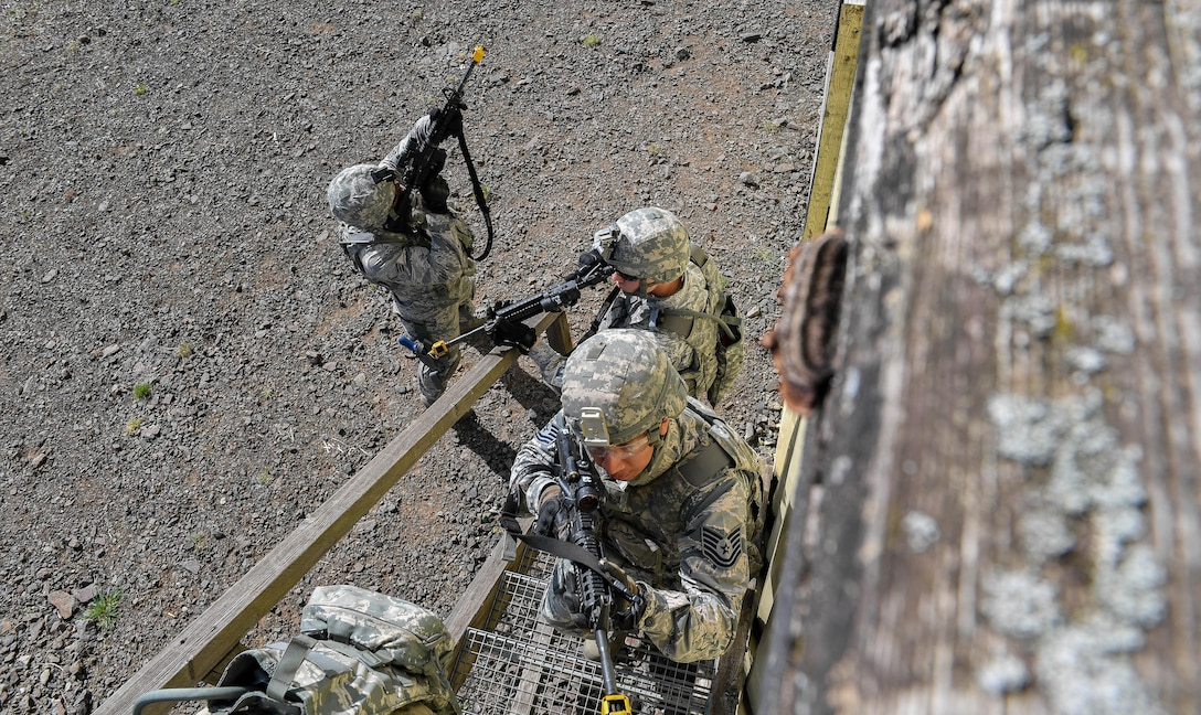 Tech. Sgt. Christian Gomez, 569th U.S. Forces Police Squadron Bravo Flight chief, and other students of the 435th Security Forces Squadron's Ground Combat Readiness Training Center's Security Operations Course climb stairs to search the top floor of a building during the urban operations portion of the course on U.S. Army Garrison Baumholder, Germany, April 4, 2017. During the urban ops portion the course, the cadres used blank rounds and flash bangs to simulate an attack upon the students. Airmen assigned to the 86th SFS, 422nd SFS, 100th SFS, and 569th USFPS participated in the course. (U.S. Air Force photo by Senior Airman Tryphena Mayhugh)