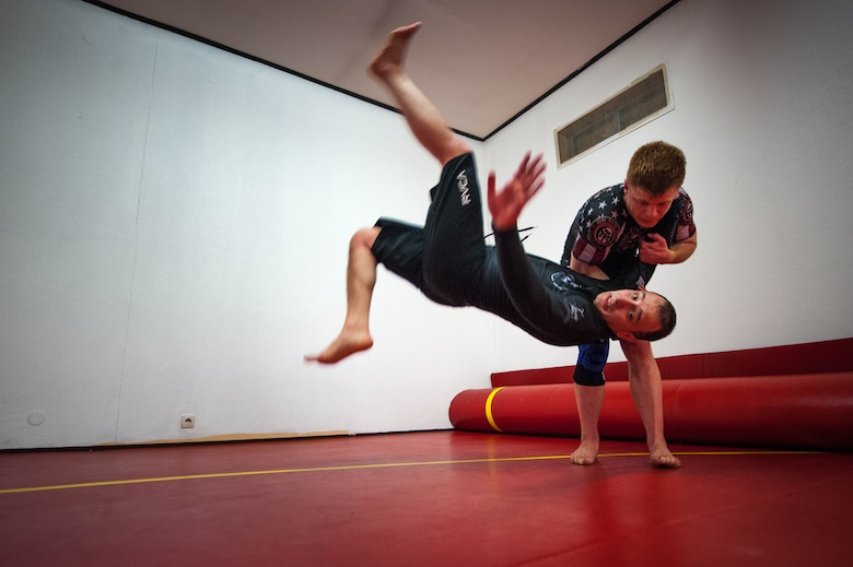 U.S. Air Force Staff Sgt. Joseph Everett, 86th Aircraft Maintenance Squadron aerospace maintenance craftsman, flips Emir Mulic over his shoulder during Brazilian Jiu Jitsu training on Ramstein Air Base, Germany, April 5, 2017. The one arm shoulder throw is a Judo move traditionally named Ippon Seoi Nage. (U.S. Air Force photo by Senior Airman Devin Boyer/Released)