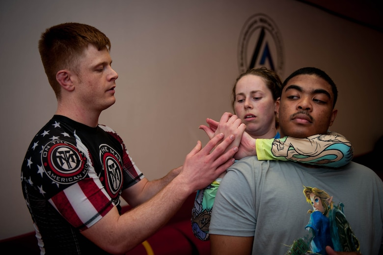 U.S. Air Force Staff Sgt. Joseph Everett, 86th Aircraft Maintenance Squadron aerospace maintenance craftsman, teaches Samantha Lamm and Senior Airman Rashid Edgington, 86th AMXS commander support staff, how to perform a move during Brazilian Jiu Jitsu training on Ramstein Air Base, Germany, April 5, 2017. Everett was showing Lamm how to secure her grip correctly to control her training partner. (U.S. Air Force photo by Senior Airman Devin Boyer/Released)
