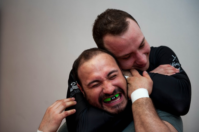 "Emir Mulic performs the Mata Leão choke while jokingly hugging Giovani Gironda, Defense Logistics Agency contracting officer, during Brazilian Jiu Jitsu training on Ramstein Air Base, Germany, April 5, 2017. Mata Leão, also known as the rear naked choke, means ""lion killer"" in Portuguese. (U.S. Air Force photo by Senior Airman Devin Boyer/Released)"