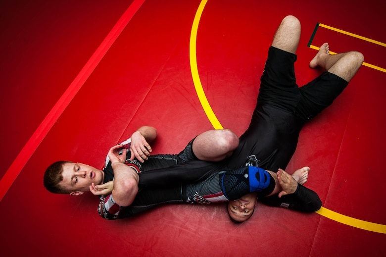 U.S. Air Force Staff Sgt. Joseph Everett, 86th Aircraft Maintenance Squadron aerospace maintenance craftsman, performs a spinning arm lock on Emir Mulic during Brazilian Jiu Jitsu training on Ramstein Air Base, Germany, April 5, 2017. Everett starts each session with a demonstration on specific moves so the trainees can practice them on each other. (U.S. Air Force photo by Senior Airman Devin Boyer/Released)