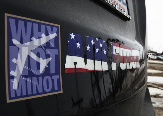 Bumper stickers are displayed on the back of a personally owned vehicle at Minot Air Force Base, N.D., March 16, 2017. Airmen may have bumper stickers on their POVs as long as they don't discredit the Air Force. (U.S. Air Force photo/Airman 1st Class Alyssa M. Akers)