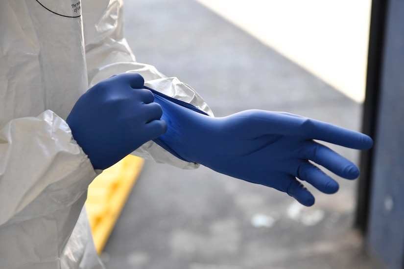 James Bundo, Medical University of South Carolina team leader, puts on a glove during a communicable disease exercise at the Charleston, S.C. Federal Law Enforcement compound April 4, 2017. The exercise, the first of its kind here, tested communication procedures and the integration of federal, state, local and private industry partners while analyzing response capabilities if an infected person needed to be transported from a vessel to the Port of Charleston.