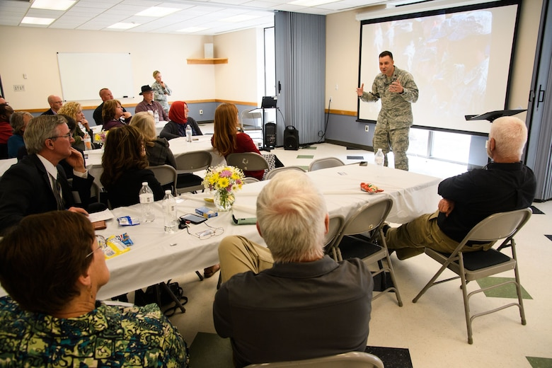 Chaplain (Maj.) Lukus Counterman, 75th Air Base Wing, speaks with local clergy during a Faith Leaders Summit at Hill Air Force Base, Utah, April 6, 2017. The event fostered resource networking and familiarized attendees with the mission, demands and operational tempo experienced by military and civilian Airmen working and living on base. (U.S. Air Force photo/R. Nial Bradshaw)
