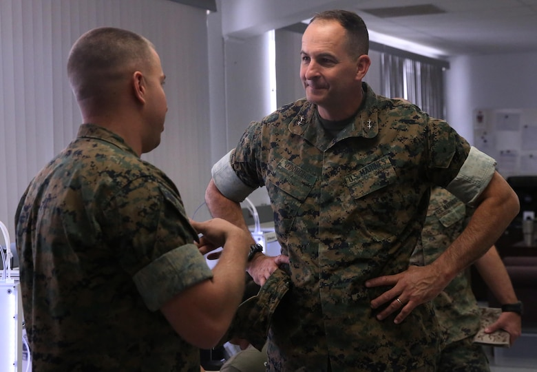 Capt. Zachary Weisenfels, left, officer in charge, Fabrication Laboratory, explains the capabilities of the FabLab to Maj. Gen. Daniel O'Donohue, Commanding General, 1st Marine Division, during a visit to Marine Corps Air Ground Combat Center, Twentynine Palms, Calif., March 29, 2017. The newly established FabLab is the first of its kind in the Marine Corps and will provide Marines and sailors the opportunity to develop avant-garde solutions to common problems through utilizing 3D printing technology. (U.S. Marine Corps photo by Cpl. Medina Ayala-Lo)