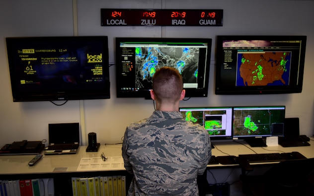 U.S. Air Force Senior Airman Alex Knowles, a weather forecaster assigned to the 509th Operations Support Squadron, studies a severe weather outbreak to see if and how it will impact base operations at Whiteman Air Force Base, Mo., March 28, 2017. All forecasters are educated in a broad spectrum of natural sciences and are current on forecast techniques, tactical equipment and data analysis. (U.S. Air Force photo by Airman 1st Class Jazmin Smith)