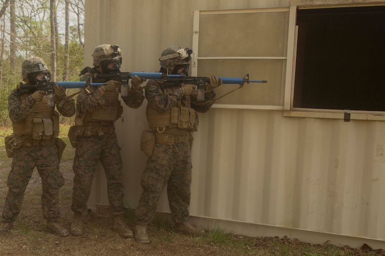 Marines prepare to secure a building during a Basic Urban Skills Training course at a Military Operations on Urbanized Terrain event at Camp Lejeune, N.C., April 5, 2017. The Marines participated in the training to learn and reinforce infantry skills as a predeployment work up. The Marines are with 2nd Light Armored Reconnaissance Battalion, Bravo Company, 2nd Marine Division. (U.S. Marine Corps photo by Pfc. Abrey D. Liggins)