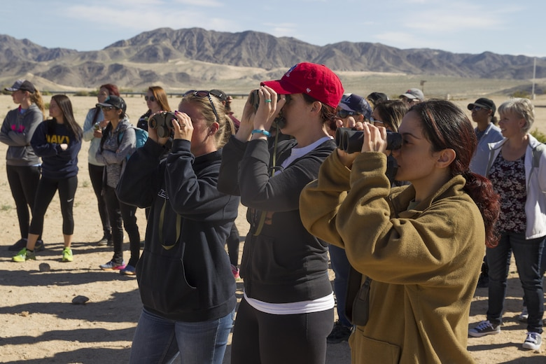 ITX for Spouses participants look for potential simulated Improvised Explosive Devices at Range 800 aboard Marine Corps Air Ground Combat Center, Twentynine Palms, Calif., March 30, 2017.  (U.S. Marine Corps photo by Cpl. Connor Hancock)