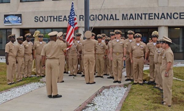 Active and retired Chief Petty Officers (CPO) render morning colors at Southeast Regional Maintenance Center (SERMC) March 31. Raising the colors is part of celebrating the birthday of the Chief, April 1st. The rank of CPO was established by President Benjamin Harrison when he signed General Order 409.