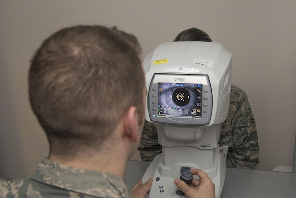 U.S. Air Force Tech. Sgt. Nicholas Hubbard, a 354th Medical Operations Squadron optometry technician, conducts an eye exam on an Airman April 3, 2017, at Eielson Air Force Base, Alaska. Hubbard believes in the value of trusted care and works to provide patients with anything they may need. (U.S. Air Force photo by Airman Eric M. Fisher)