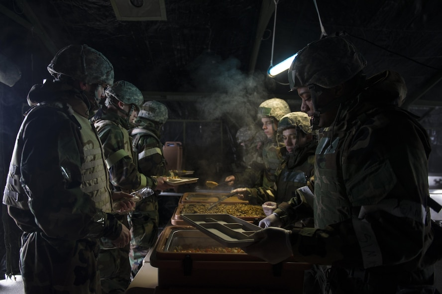 U.S. Air Force Airman Terrance Allen, a 354th Force Support Squadron food service apprentice, serves Airmen during chemical warfare training for exercise Arctic Gold 17-5 April 6, 2017, at Spruce Lake on Eielson Air Force Base, Alaska. During the training, food services members participated in most of the events while also serving hot breakfast and lunch. (U.S. Air Force photo by Airman 1st Class Isaac Johnson)