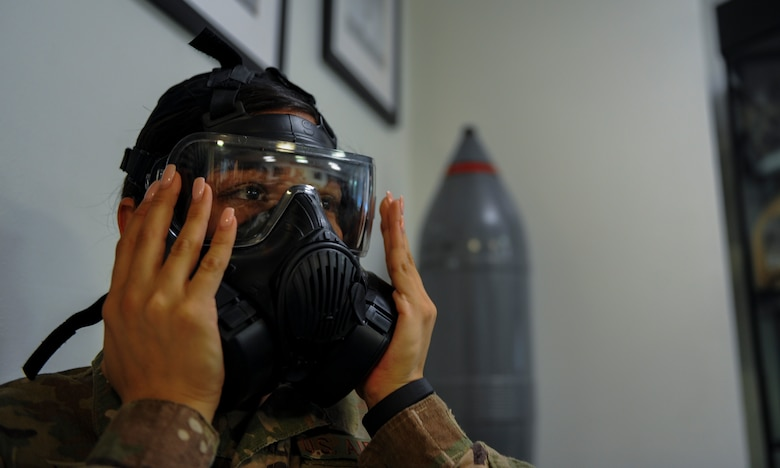 Senior Airman Felicia Arriola an administrative assistant with the 1st Special Operations Maintenance Squadron, tries on a gas mask to ensure it is properly sealed during a chemical, biological, radiological and nuclear survival skills class at Hurlburt Field, Fla., April 4, 2017. The classe teach Air Commandos how to properly inspect, don and wear the Chemical Protective Overgarment in case of a chemical warfare related attack. (U.S. Air Force photo by Airman 1st Class Isaac O. Guest IV)