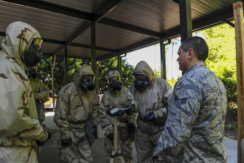 Senior Airman John Rolofson III, an emergency management journeyman with the 1st Special Operations Civil Engineer Squadron, briefs Air Commandos on how to detect liquid contamination on M8 paper on a liquid detection point during a chemical, biological, radiological and nuclear survival skills at Hurlburt Field, Fla., April 4 2017. Hands-on training teaches Air Commandos how to run a PAR Route, or Post Attack Reconnaissance, set up a zone transition point and LDPs. (U.S. Air Force photo by Airman 1st Class Isaac O. Guest IV)