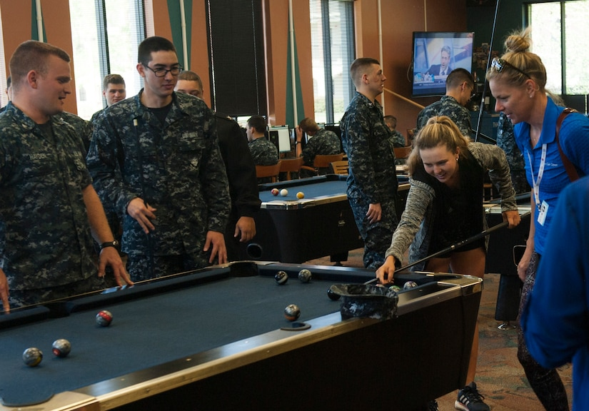 Kayla Day, professional tennis player, plays a game of pool with Naval Nuclear Power Training Unit students April 4, 2017, at the Bowman Center on Joint Base Charleston - Weapons Station, S.C. Day toured the NNPTU campus and signed autographs for Team Charleston members while she was in the Charleston area to compete in the Volvo Car Open tennis tournament.