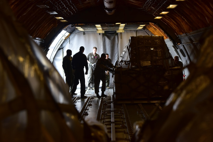 Airmen with the 509th and 131st Logistics Readiness Squadrons load a KC-10 Extender aircraft with 70 pallets of food in support of Convoy of Hope at Whiteman Air Force Base, Mo., April 1, 2017. More than 84,000 pounds of fortified rice and soy protein were convoyed in an initiative to feed more than 65,000 children in Haiti. (U.S. Air Force photo by Senior Airman Jovan Banks)