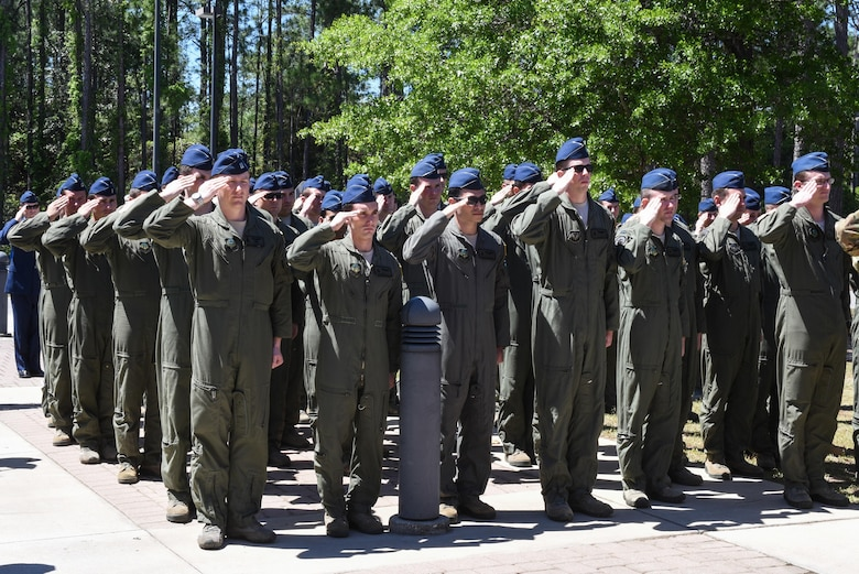 Members of the 319th Special Operations Squadron present arms during the national anthem at the 319th SOS building renaming and dedication ceremony at Hurlburt Field, Fla., April 7, 2017. The 319th SOS building was renamed and dedicated to retired Lt. Col. Richard E. Cole, the last surviving Doolittle Raider and co-pilot to then-Lt. Col. James H. Doolittle. (U.S. Air Force photo by Senior Airman Jeff Parkinson)
