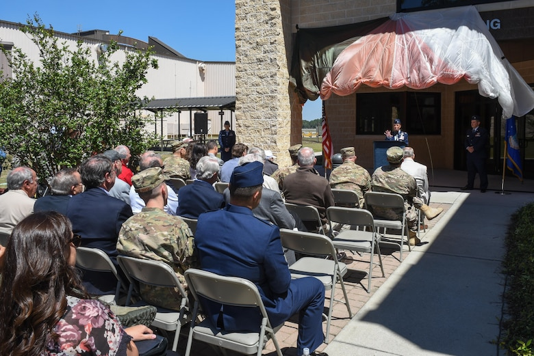 Lt. Col. Allison Black, the commander of the 319th Special Operations Squadron, delivers remarks on retired Lt. Col. Richard E. Cole, the last surviving Doolittle Raider, during the 319th SOS building renaming and dedication ceremony at Hurlburt Field, Fla., April 7, 2017. The building was renamed after Cole, who retired from active duty with a list of accomplishments and awards that includes: the Distinguished Flying Cross with two oak leaf clusters, the Bronze Star medal, the Air Force Commendation medal, the Chinese Army, Navy, Air Corps medal, Class A, 1st Grade. (U.S. Air Force photo by Senior Airman Jeff Parkinson)