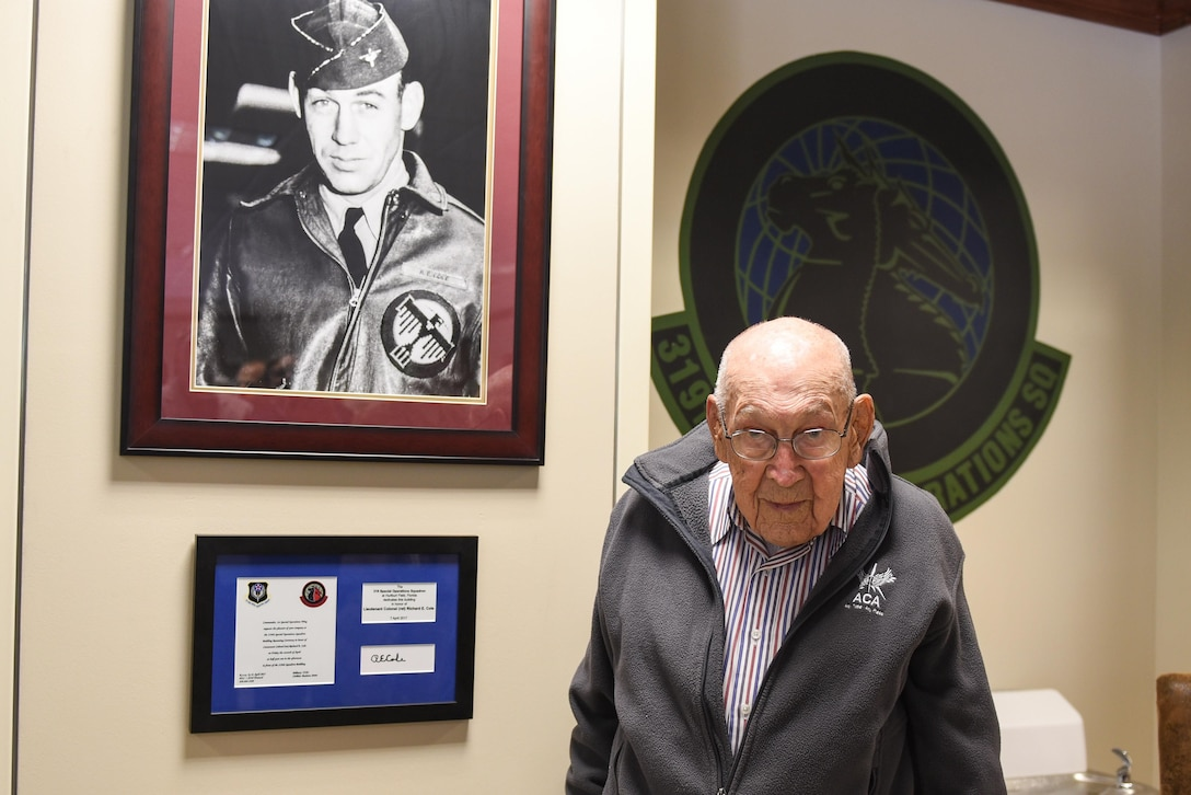 Retired Lt. Col. Richard E. Cole stands with a portrait of himself from his time in the Army Air Corps during World War II at the 319th Special Operations Squadron, Hurlburt Field Fla., April 7, 2017. In early 1942, Cole volunteered for Special Mission Number 1, which trained at Eglin Air Field, and on April 18, 1942, he served as then-Lt. Col. James H. Doolittle's co-pilot during the Raid on Tokyo. (U.S. Air Force photo by Senior Airman Jeff Parkinson)