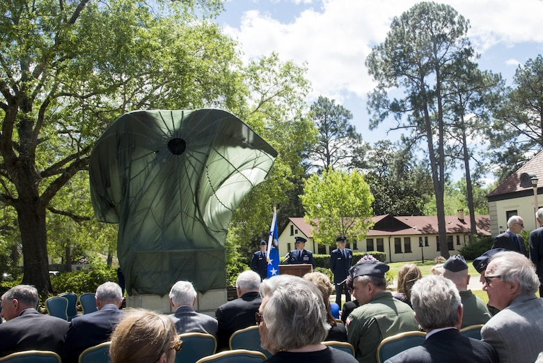 Attendees await for the official unveiling of the Daedalus statue outside of the Maxwell Club, Thursday, April 6, 2017, Maxwell Air Force Base, Ala. The statue was commissioned and donated by Montgomery business owner, Nimrod Frazer, who is a Korean War veteran and Silver Star recipient. (U.S. Air Force photo/ Senior Airman Alexa Culbert)