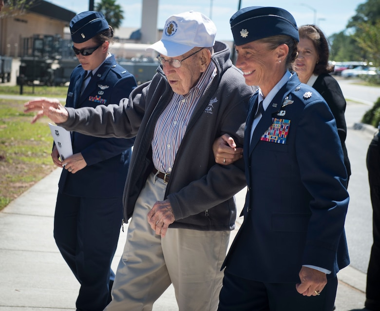 Lt. Col. Allison Black, the commander of the 319th Special Operation Squadron, escorts retired Lt. Col. Richard E. Cole before a building renaming and dedication ceremony at Hurlburt Field, Fla., April 7, 2017. Cole is the last surviving Doolittle Raider whose Air Force roots date back to the origination of the 319th SOS. (U.S. Air Force photo by Senior Airman Krystal M. Garrett)