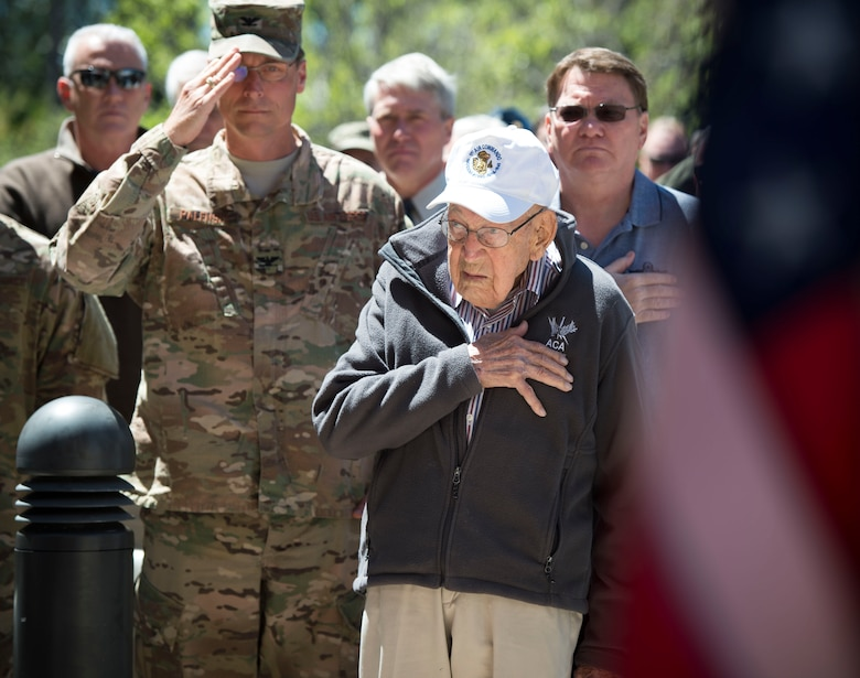 Retired Lt. Col. Richard E. Cole stands for the national anthem during a building renaming and dedication ceremony at Hurlburt Field, Fla., April 7, 2017.  The 319th Special Operations Squadron building was renamed after Cole in honor of his career as an early Air Commando and Doolittle Raider. (U.S. Air Force photo by Senior Airman Krystal M. Garret)