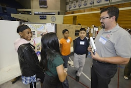 David Bogema, U.S. Army Corps of Engineers Nashville,  civil engineer in the Water Management section talks with students from the Madison Middle School in Goodlettesvill, Tenn., during the Science, Technology, Engineering and Mathematics Expo at Tennessee State University Gentry Center April 6, 2017.