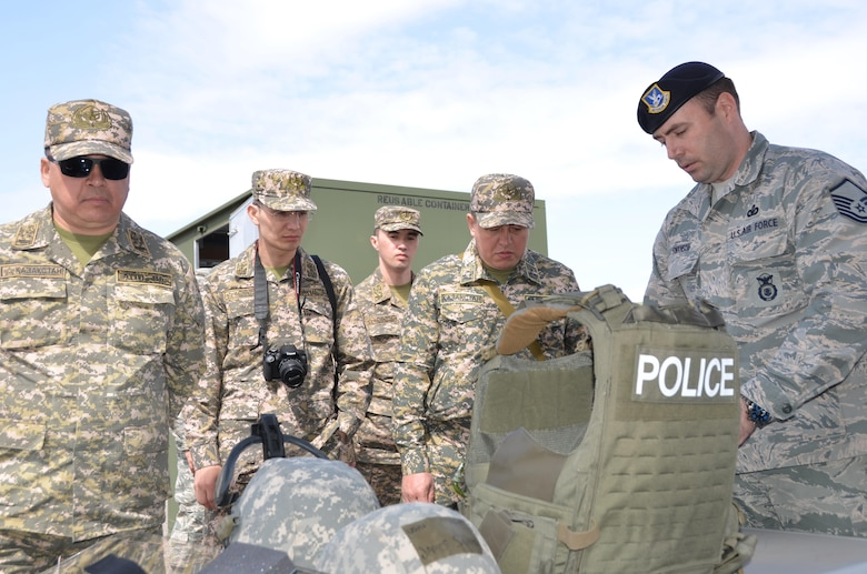 Air Force Master Sgt. James Swanson (right), security forces operations superintendent for the 161st Security Forces Squadron, shows a delegation of Kazakh military officers law enforcement gear during a tour of Goldwater Air National Guard Base. The Arizona Air National Guard hosted the officers, March 31, as part of the National Guard's State Partnership Program. (U.S. Air National Guard photo by 2nd Lt. Tinashe Machona).