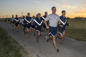 """Members of the 350th Battlefield Airmen Training Squadron and Airmen from throughout Joint Base San Antonio-Lackland complete a run during a memorial remembrance ceremony honoring Lt. Col. William """"Bill"""" Schroeder April 7, 2017, at JBSA-Lackland, Texas, Medina Annex. Schroeder's unit honored his legacy by renaming a drop zone as Schroeder DZ and participated in a """"Monster Mash"""" fitness competition, remembrance ceremony and log march. On April 8th, 2016 Schroeder recognized a perilous situation developing and reacted swiftly by putting himself between an armed individual and his first sergeant. In the process, he saved lives of other squadron members while being fatally wounded. Schroeder was posthumously awarded the Airman's Medal, given to those that distinguish themselves by a heroic act – usually at the volunteer risk of their lives but not involving combat.  (U.S. Air Force photo by Johnny Saldivar)"""
