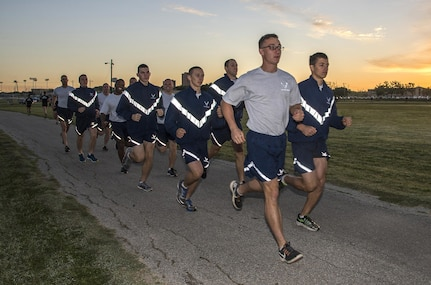 "Members of the 350th Battlefield Airmen Training Squadron and Airmen from throughout Joint Base San Antonio-Lackland complete a run during a memorial remembrance ceremony honoring Lt. Col. William ""Bill"" Schroeder April 7, 2017, at JBSA-Lackland, Texas, Medina Annex. Schroeder's unit honored his legacy by renaming a drop zone as Schroeder DZ and participated in a ""Monster Mash"" fitness competition, remembrance ceremony and log march. On April 8th, 2016 Schroeder recognized a perilous situation developing and reacted swiftly by putting himself between an armed individual and his first sergeant. In the process, he saved lives of other squadron members while being fatally wounded. Schroeder was posthumously awarded the Airman's Medal, given to those that distinguish themselves by a heroic act – usually at the volunteer risk of their lives but not involving combat.  (U.S. Air Force photo by Johnny Saldivar)"