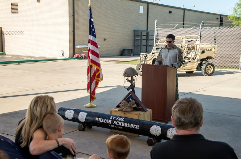 """Col. Ronald Stenger, Battlefield Airmen Training Group commander, addresses the crowd during a memorial remembrance ceremony honoring Lt. Col. William """"Bill"""" Schroeder April 7, 2017, at JBSA-Lackland, Texas, Medina Annex. Schroeder's unit honored his legacy by renaming a drop zone as Schroeder DZ and participated in a """"Monster Mash"""" fitness competition, remembrance ceremony and log march.  On April 8th, 2016 Schroeder recognized a perilous situation developing and reacted swiftly by putting himself between an armed individual and his first sergeant. In the process, he saved lives of other squadron members while being fatally wounded. Schroeder was posthumously awarded the Airman's Medal, given to those that distinguish themselves by a heroic act – usually at the volunteer risk of their lives but not involving combat. (U.S. Air Force photo by Johnny Saldivar)"""