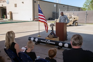 """Col. Roy Collins, 37th Training Wing commander, prepares to address the crowd during a memorial remembrance ceremony honoring Lt. Col. William """"Bill"""" Schroeder April 7, 2017, at JBSA-Lackland, Texas, Medina Annex. Schroeder's unit honored his legacy renaming a drop zone as Schroeder DZ and participated in a """"Monster Mash"""" fitness competition, remembrance ceremony and log march. On April 8, 2016, Schroeder recognized a perilous situation developing and reacted swiftly by putting himself between an armed individual and his first sergeant. In the process, he saved lives of other squadron members while being fatally wounded. Schroeder was posthumously awarded the Airman's Medal, given to those that distinguish themselves by a heroic act – usually at the volunteer risk of their lives but not involving combat.  (U.S. Air Force photo by Johnny Saldivar)"""