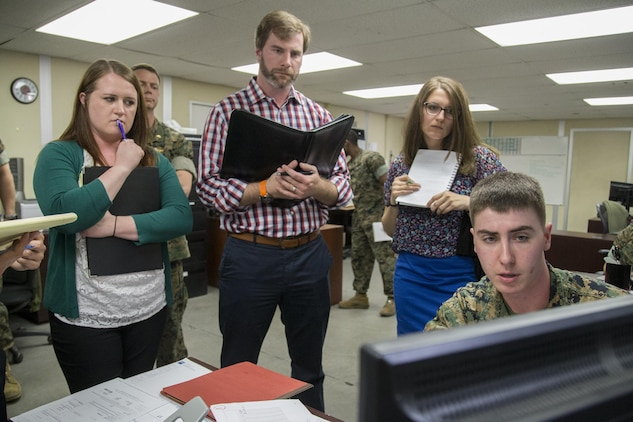 U.S. Marine Corps Lance Cpl. Christian Jacobs, procurement clerk, right, explains to the Marine Corps Administrative Analysis Team how he records information in the system at 1st Medical Logistics Battalion, 1st Marine Logistics Group, during a fiscal year 17 audit on Camp Pendleton, Calif., April 6, 2017. (U.S. Marine Corps photo by Lance Cpl. Betzabeth Y. Galvan)