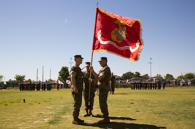 Maj. Gen. Burke W. Whitman (left), the incoming commanding general of 4th Marine Division, accepts the Marine Corps Colors from Brig. Gen. Paul K. Lebidine (right), the outgoing commanding general of 4th Marine Division, during a change of command ceremony at Marine Corps Support Facility New Orleans, April 7, 2017. Whitman assumes leadership of the largest division command in the Marine Corps. (U.S. Marine Corps photo by Pfc. Niles Lee/Released)